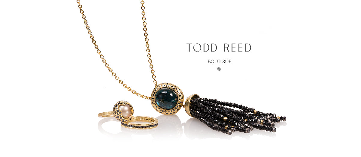 "necklace and rings with the words ""Todd Reed Boutique"" on white background"