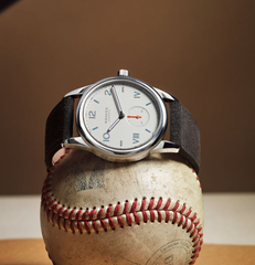 Nomos watch on top of a baseball