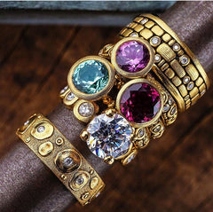 Alex Sepkus 18K yellow gold rings martini setting purple blue
