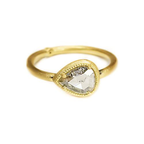 yellow gold ring with pear cut diamond in teardrop shape
