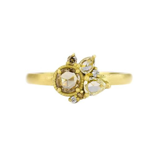 Samantha Louise half bouquet ring with gold and diamonds of all shapes and sizes, featuring pear-cut diamonds