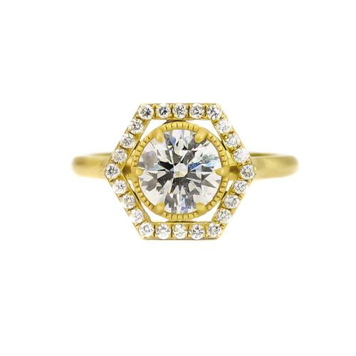 custom Samantha Louise ring with large circular diamond and pave diamonds in hexagon pattern on yellow gold band