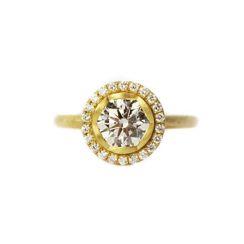 18K yellow gold ring with round brilliant cut diamond center and round diamond halo