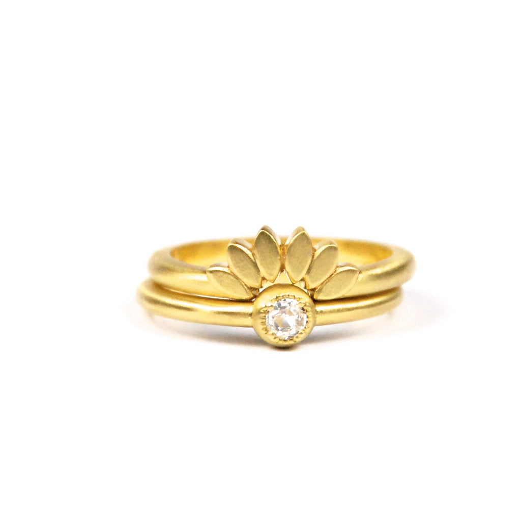 18K yellow gold Petal tracer band show in stack with 18K yellow gold round diamond solitaire