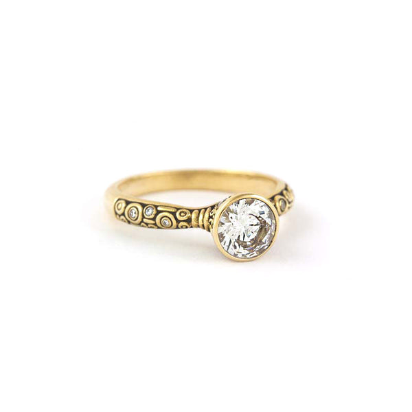 "Alex Sepkus 18K yellow gold ""Martini"" ring with one 1.01 carat Hearts on Fire round brilliant cut diamond and 13 round bezel set accent diamonds (0.15ctw)."