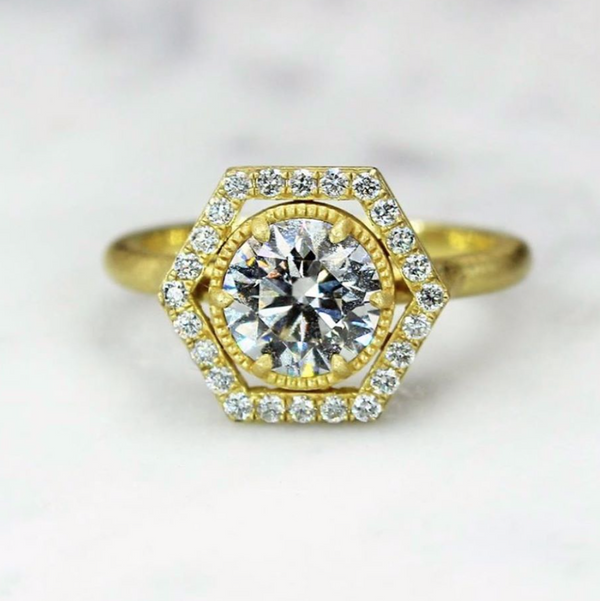 18K yellow gold ring with round brilliant cut diamond center and hexagon shape round diamond halo