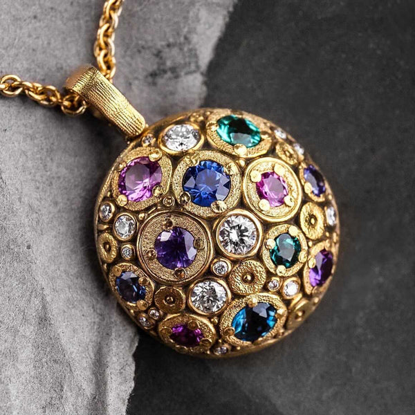 "18K yellow gold ""Blooming Hill"" pendant with diamond and gemstone mix, dark background"
