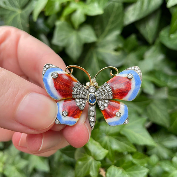 18K yellow gold, blue-red enamel, diamond and sapphire butterfly brooch, green leaf background