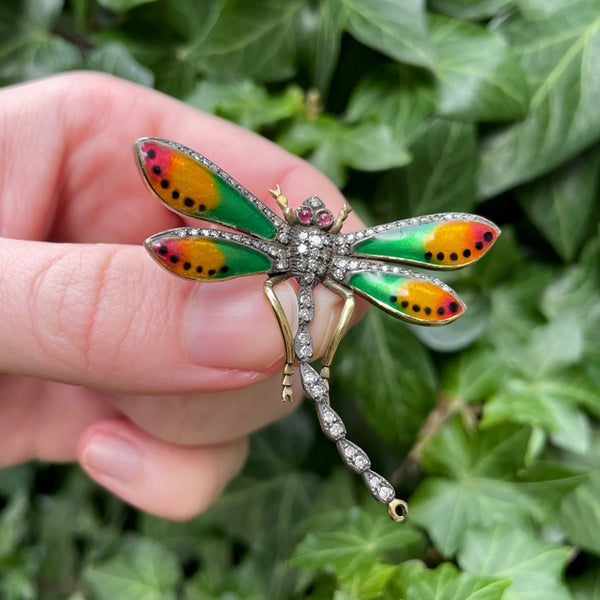 18K yellow gold, diamond, ruby, and red-yellow-green enamel dragonfly brooch, green leaf background