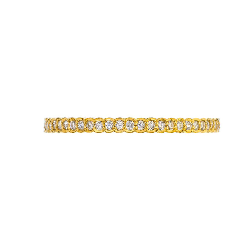 18K yellow gold and 0.30ctw diamonds in a scallop style eternity band