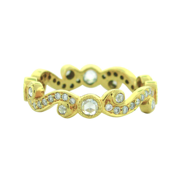 Sethi Couture scroll-themed ring with yellow gold swirl pattern and diamonds of all sizes