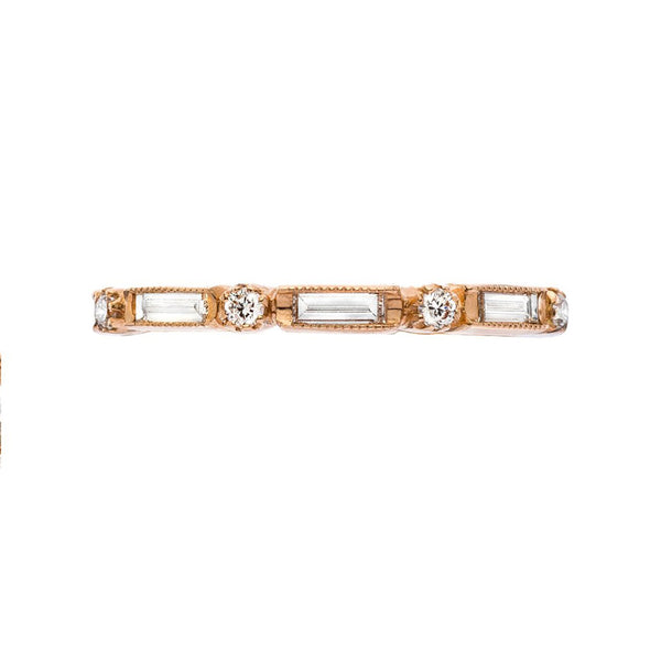 "18K rose gold ""Lucy"" eternity band with baguette cut and round brilliant cut diamonds"