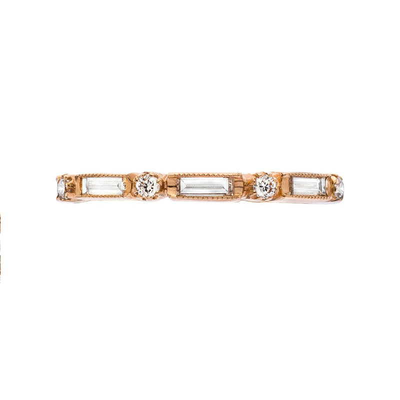 18K rose gold eternity band with bezel set round and baguette cut diamonds, 0.81ctw