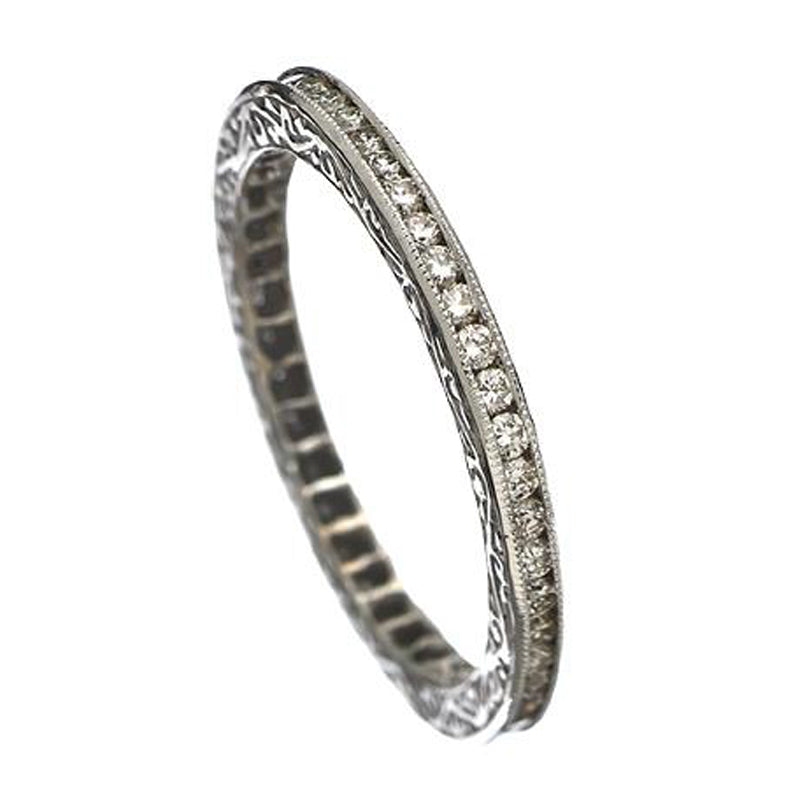 Sethi diamond eternity band with large and small diamonds all around