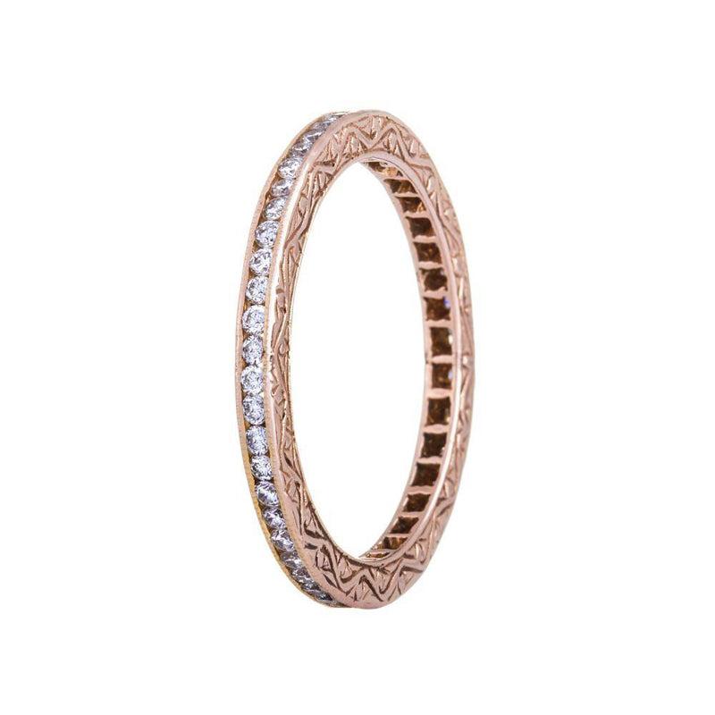 18K rose gold channel set diamond eternity band with hand engraving on the sides