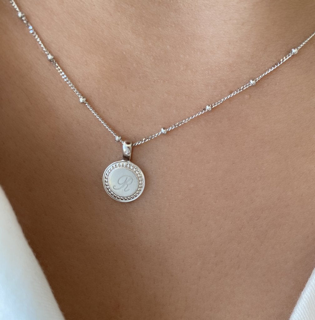 Beautifully engraved necklace with R on circular white gold charm