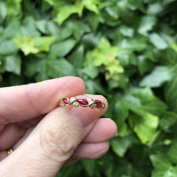 18K yellow gold ring with round diamonds and three marquise cut rubies
