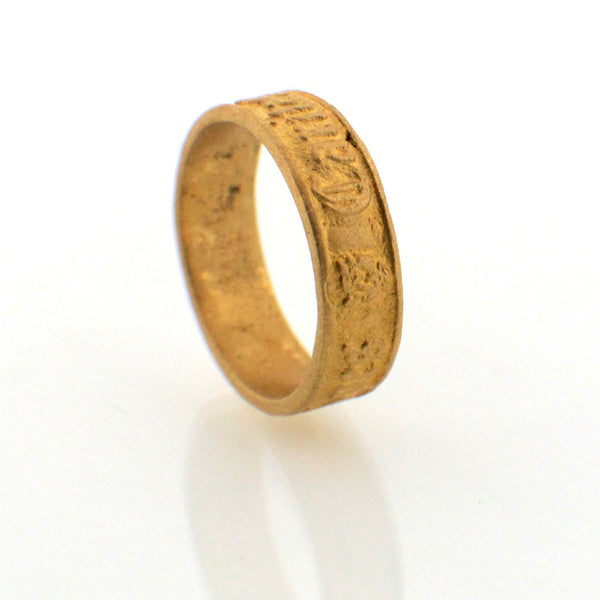 "Renaissance-themed Suwa ring with ""Faith hope love"" engraved in Latin"