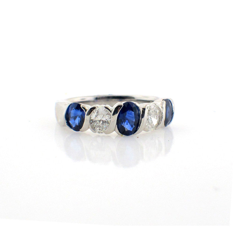 Suwa sapphire ring with three large oval-cut sapphires set in platinum with two large diamonds