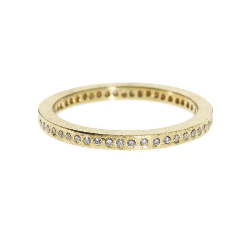 Todd Reed rough-textured yellow gold ring set with tiny diamonds