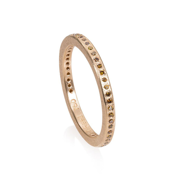 18K rose gold eternity band with flush set Autumn color diamonds