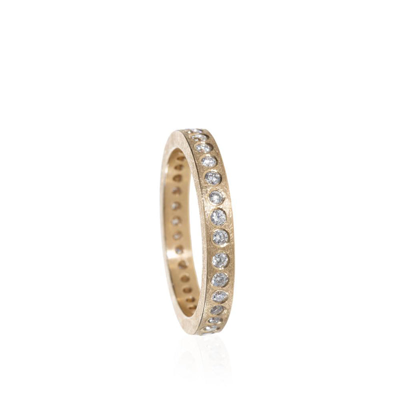Todd Reed rose gold ring with rough texture and diamonds set into grooves