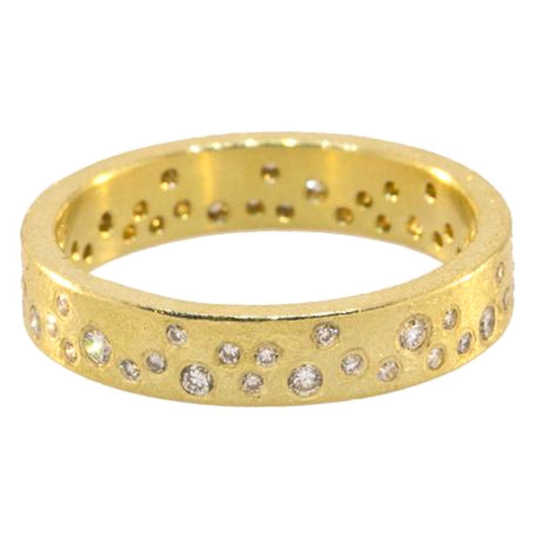 Todd Reed wedding band, eternity-ring style with round diamonds set in 18k gold