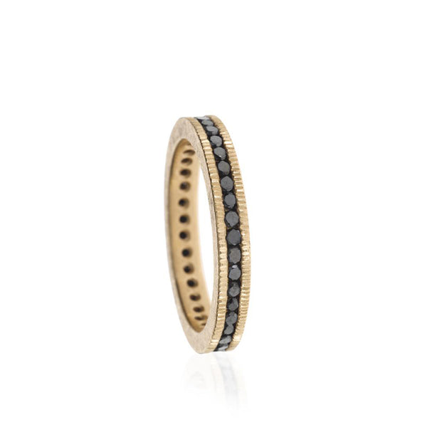 Todd Reed eternity band with coin-inspired edges and channel-set black diamonds