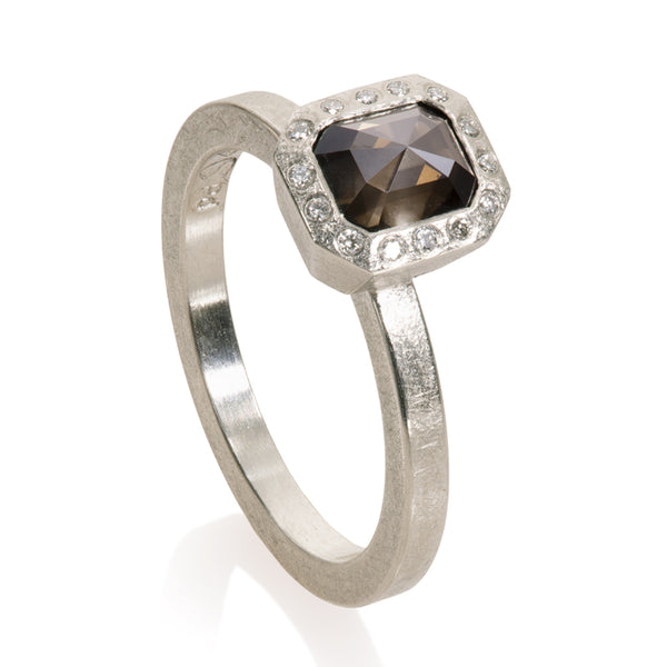 Palladium ring with fancy cut rectangular shape brownish-grey diamond center with flush set white diamond halo