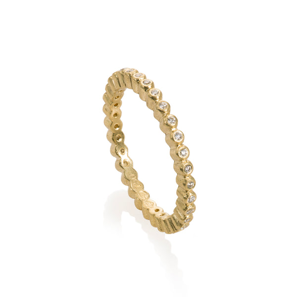 Todd Reed diamond ring with round diamonds in bezel set 18k gold eternity ring