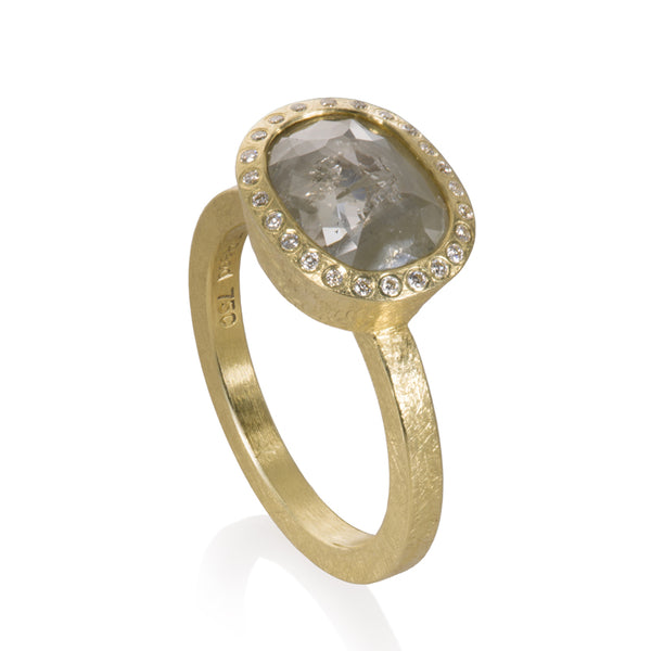 18K yellow gold fancy cut grey oval diamond ring with flush set white diamond halo