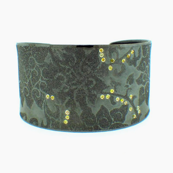 Atelier Zobel large green cuff with paisley design and tiny orange diamonds