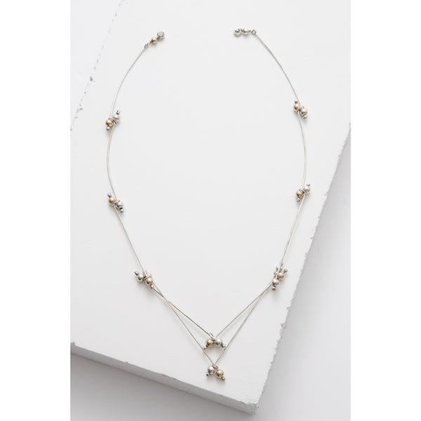 Zuzko v neck necklace shaped in double V pattern with tiny gold and silver beads