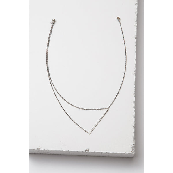 asymmetric designer necklace by Zuzko with two silver chains with magnetic clasp