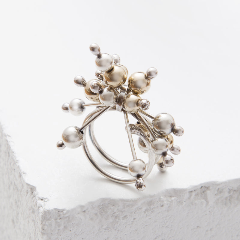 Zuzko Jax ring inspired by microscopic particle with tiny gold and silver beads