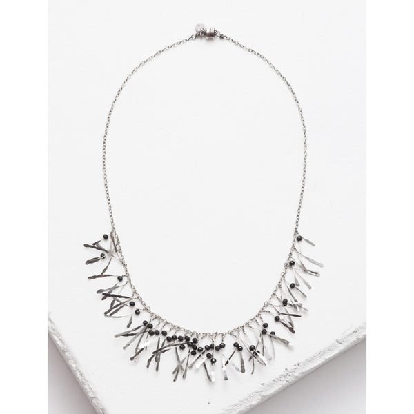 Zuzko boa necklace in silver with tiny black garnet beads and dangling silver strands in semi circle on silver chain
