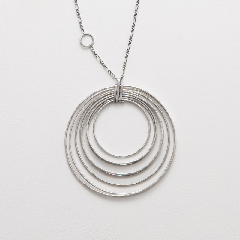 Zuzko silver stacked necklace with concentric circles in angled waterdrop shape