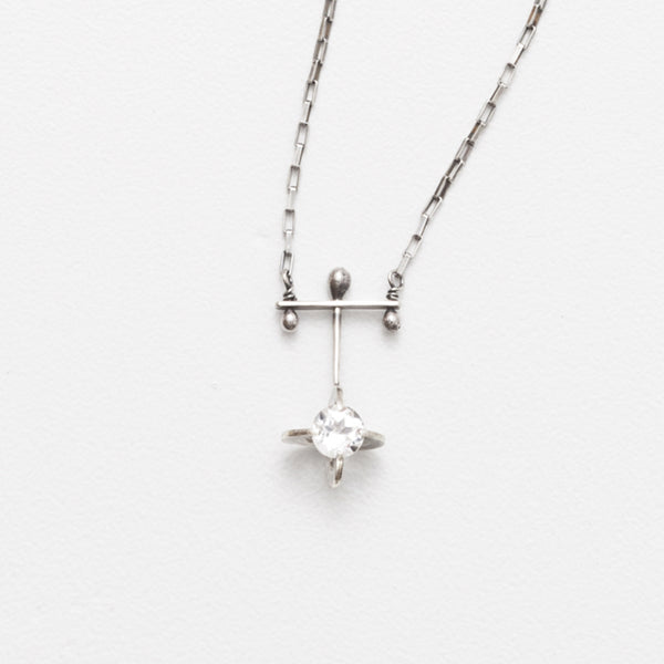 Zuzko Clutch necklace, sterling silver with atom shape dangled from silver chain on cross shape