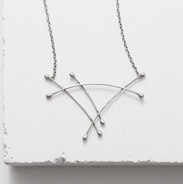 Zuzko silver Sail necklace with stacked cotton swab design