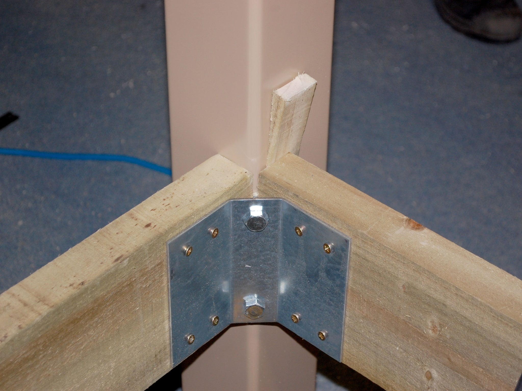 deck frame metal bracket with post attached