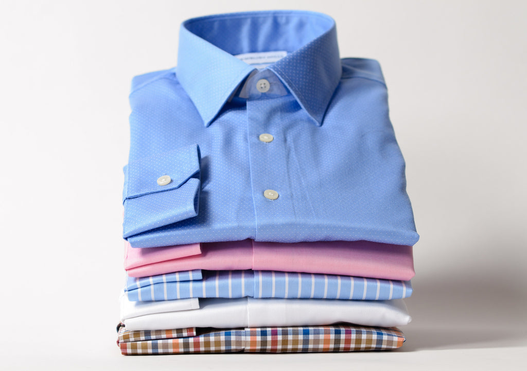 Stack of Newbury Mills dress shirts