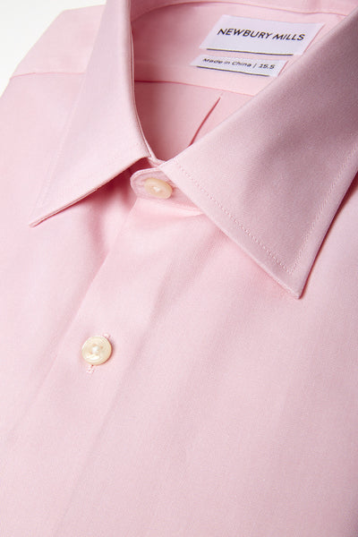 Solid Peach shirt folded with close up of fabric