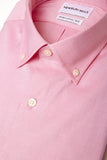Peach Oxford Button Down shirt folded with close up of fabric