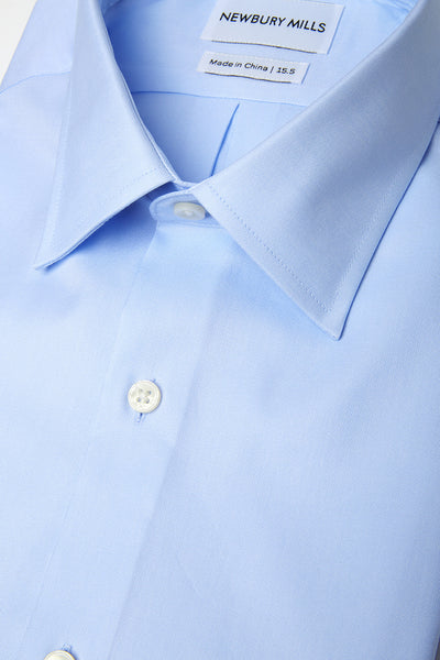 Solid Blue shirt folded with close up of fabric