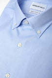 Blue Oxford Button Down Shirt Folded. Fabric Closeup.