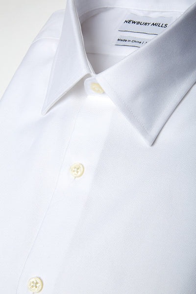 Solid White shirt folded with close up of fabric