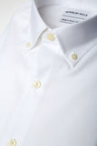White Oxford Button Down shirt folded with closeup of fabric