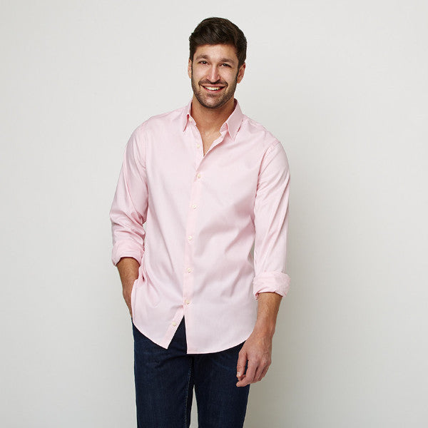 Solid Peach shirt worn casually untucked