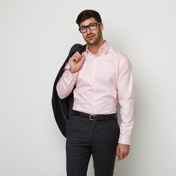 Solid Peach shirt worn formally tucked in with suit and glasses