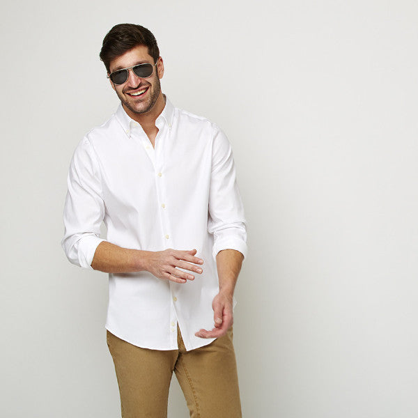 White Oxford Button Down shirt worn casually untucked with sunglasses